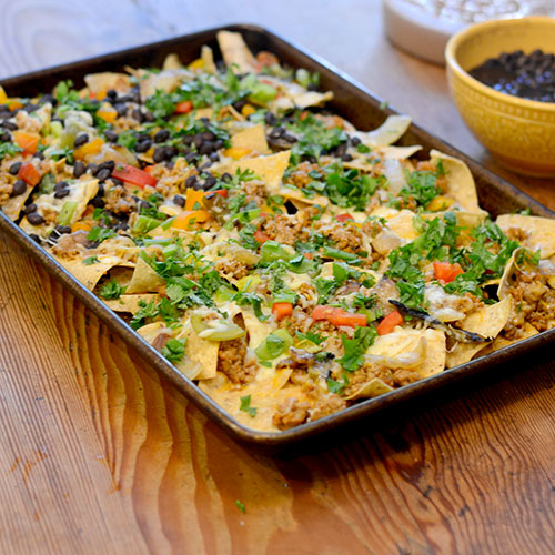 nachos, Mexican, cheese, ground turkey, black beans, peppers & cilantro