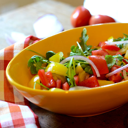 salad, yellow tomatoes, red peppers, red onions, arugula, lettuce