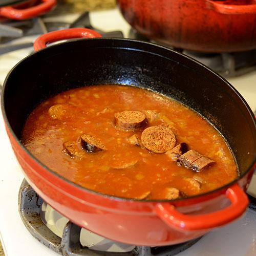 Chorizo, broth, saffron, spices