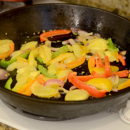 skillet, peppers, tomatoes, red onions