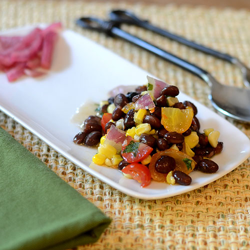 Plated, black beans, corn, salsa, cilantro, lime juice, red onions, tomatoes, olive oil