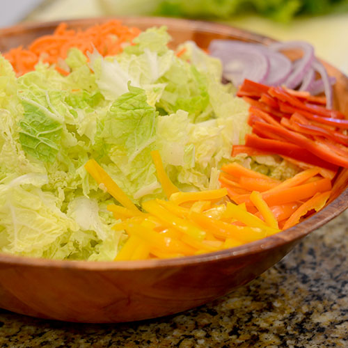 napa cabbage, carrots, red onion, sweet peppers, cumin, dill, fat-free yogurt, mayonnaise, celery salt, lime pepper
