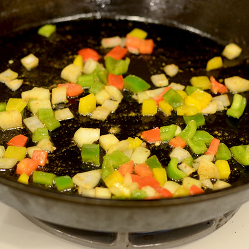 Saute vegetables, peppers, onions