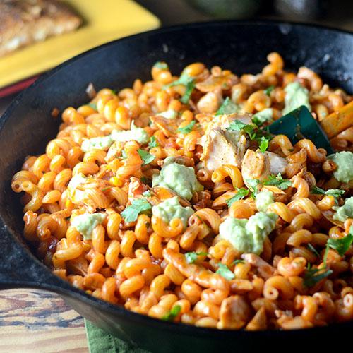 pasta, salmon, enchilada sauce, tomatoes with green chilies, coconut milk, corn, onions, avocado, salt, pepper, Mexican Chili Powder, Adobo Seasoning