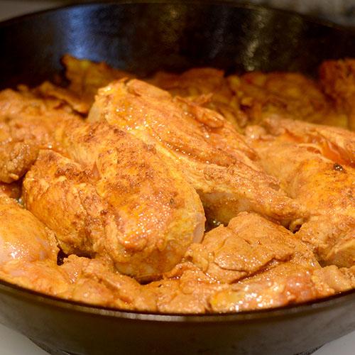 Marinated Chicken Added to Skillet