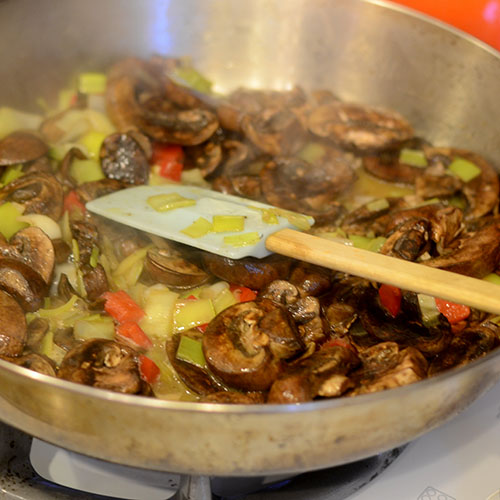 Mushrooms and Red Peppers Added to the Leeks