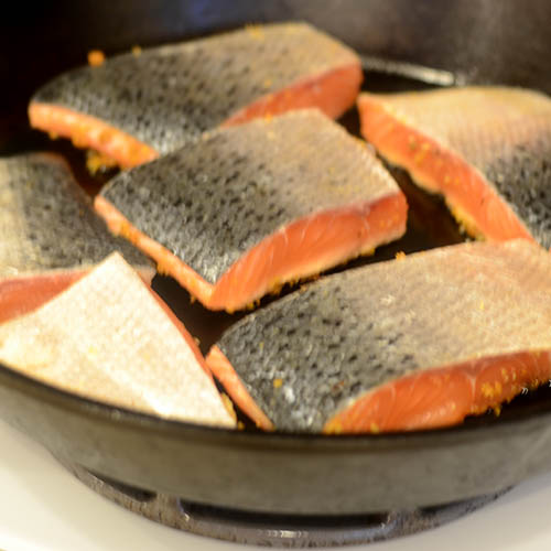 Salmon Fillets Cut with Crimson Knife and in Skillet