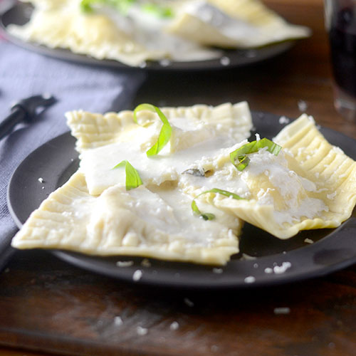 Ravioli with a Basil Cream Sauce #pasta #basil #ravioli | feedyoursoul2.com