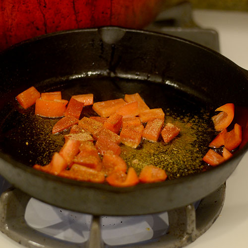 Red Peppers and Creole Seasonings in Skillet
