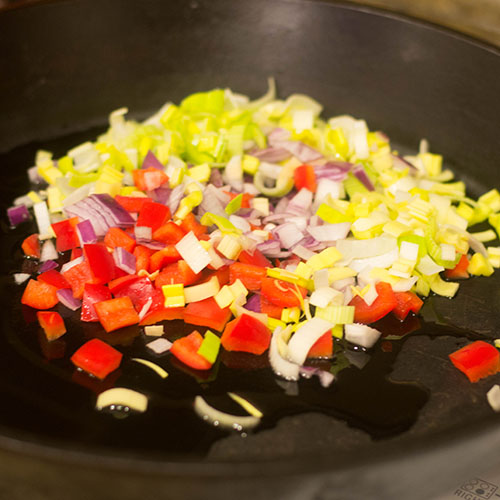 Sauteing onions, peppers and leeks.