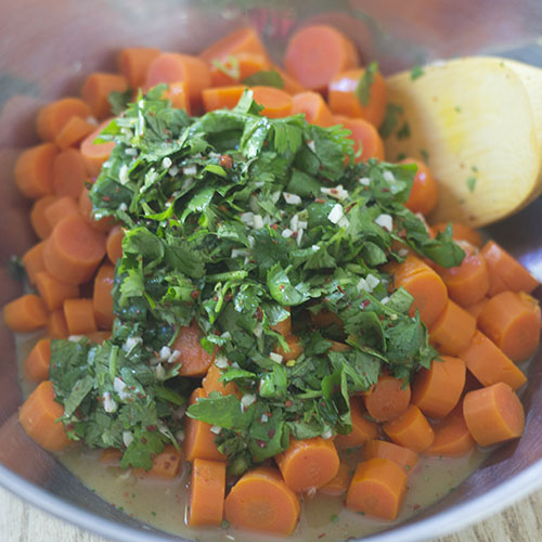 Carrots, spices, herbs and juice in Mixing Bowl