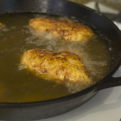 Chicken Frying in Cast Iron Skillet