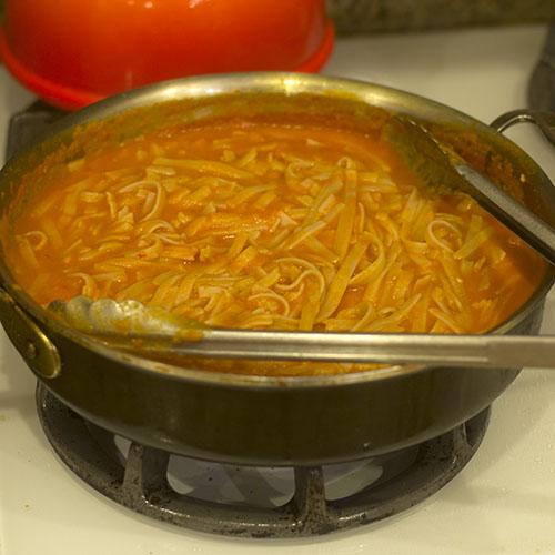 Gluten Free Noodles Mixed into Vegan Tomato Sauce