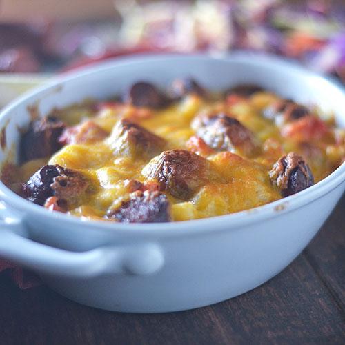Hominy Smoked Sausage Cheesy Casserole #Caserole #sausage #hominy #glutenfree | feedyoursoul2.com